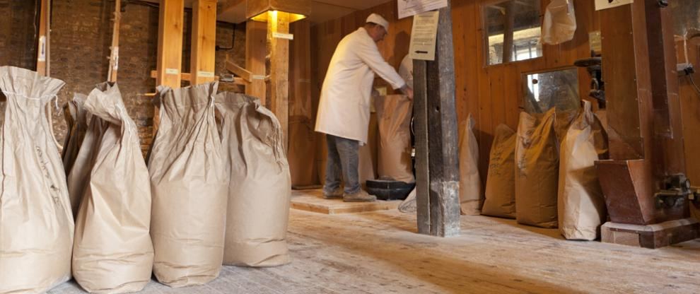 Weighing a sack of flour at Redbournbury Mill